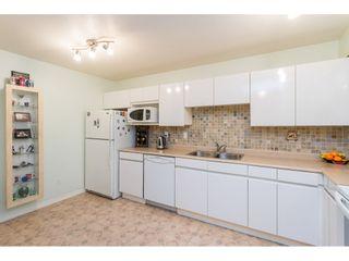 Photo 3: 404 3065 PRIMROSE LANE in Coquitlam: North Coquitlam Condo for sale : MLS®# R2428749