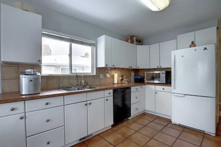 Photo 10: 75 FAIRVIEW Crescent SE in Calgary: Fairview Detached for sale : MLS®# A1057690