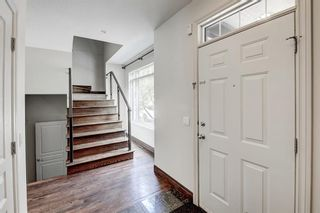 Photo 4: 29 Somme Boulevard SW in Calgary: Garrison Woods Row/Townhouse for sale : MLS®# A1129180