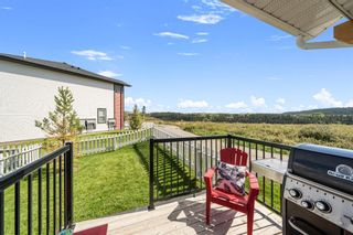 Photo 27: 1404 Jumping Pound Common: Cochrane Row/Townhouse for sale : MLS®# A1146897