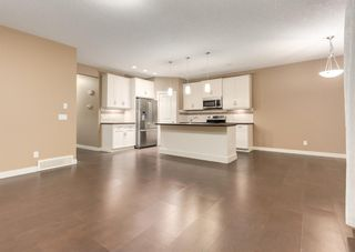 Photo 6: 150 AUTUMN Circle SE in Calgary: Auburn Bay Detached for sale : MLS®# A1089231