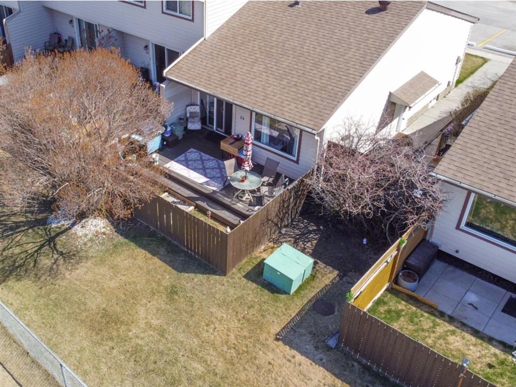 Main Photo: 24 6100 4 Avenue NE in Calgary: Marlborough Park Semi Detached for sale : MLS®# A1102275
