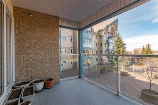 Photo 18: 218 7239 Sierra Morena Boulevard SW in Calgary: Signal Hill Apartment for sale : MLS®# A1102814