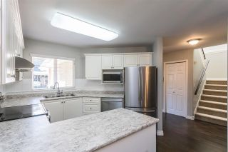 """Photo 2: 11 12038 62 Avenue in Surrey: Panorama Ridge Townhouse for sale in """"Pacific Gardens"""" : MLS®# R2568380"""