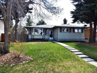 Main Photo: 1723 110 Avenue SW in Calgary: Braeside_Braesde Est House for sale : MLS®# C4000766