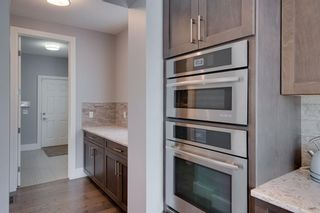 Photo 10: 100 Cranbrook Heights SE in Calgary: Cranston Detached for sale : MLS®# A1140712