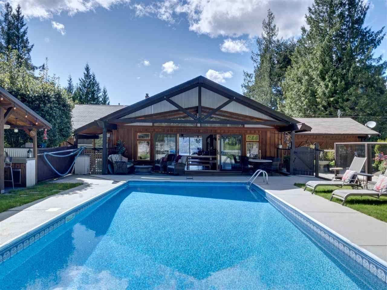 Main Photo: 7117 SECHELT INLET Road in Sechelt: Sechelt District House for sale (Sunshine Coast)  : MLS®# R2578615