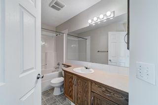 Photo 29: 4 136 Bow Ridge Drive: Cochrane Row/Townhouse for sale : MLS®# A1116097