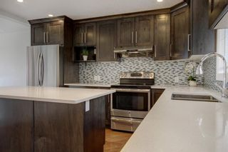 Photo 5: 93 Sidon Crescent SW in Calgary: Signal Hill Detached for sale : MLS®# A1150956