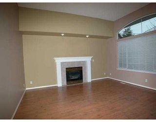 """Photo 2: 2496 COAST MERIDIAN Road in Port Coquitlam: Riverwood House for sale in """"BIRCHLAND MANOR"""" : MLS®# V635754"""