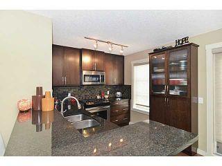 Photo 8: 30 ASPEN HILLS Green SW in : Aspen Woods Townhouse for sale (Calgary)  : MLS®# C3575868