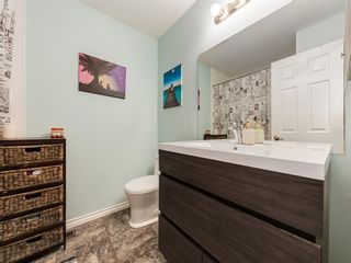 Photo 18: 8 220 ERIN MOUNT Crescent SE in Calgary: Erin Woods Row/Townhouse for sale : MLS®# A1088896