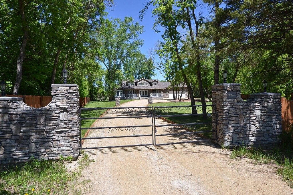 RARE FIND! Mature Treed 9.93 Acre lot South of Birds Hill Park. Unique Classic Character! Stunning Executive Style 1951 sf 3 Bedroom Bungalow, Cultured Stone Pillars, Decorative Metal Gate, Tree Lined Circle Drive, Landscaped, Sodded & Fenced Yardsite.