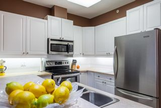 Photo 10: 310 910 70 Avenue SW in Calgary: Kelvin Grove Apartment for sale : MLS®# A1061189