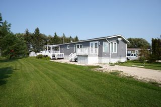 Photo 1: 35 North Drive in Portage la Prairie RM: House for sale : MLS®# 202121805