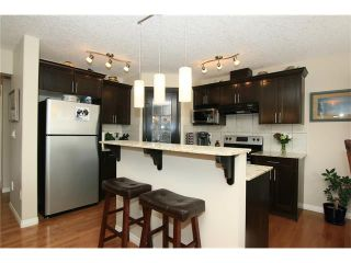 Photo 7: 1857 BAYWATER Street SW: Airdrie House for sale : MLS®# C4104542