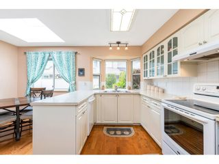 """Photo 7: 6139 W BOUNDARY Drive in Surrey: Panorama Ridge Townhouse for sale in """"LAKEWOOD GARDENS"""" : MLS®# R2452648"""