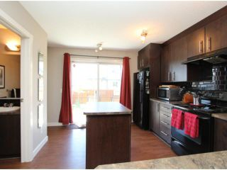 Photo 15: 602 2445 KINGSLAND Road SE: Airdrie Townhouse for sale : MLS®# C3624049