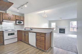 Photo 2: 70 Tararidge Circle NE in Calgary: Taradale Row/Townhouse for sale : MLS®# A1131868