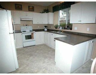 Photo 2: 2511 AMBER CT in Coquitlam: Westwood Plateau House for sale : MLS®# V585207