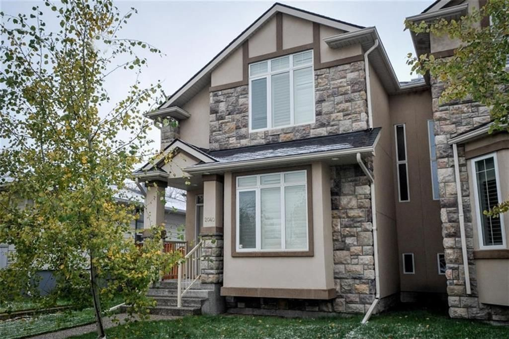 Main Photo: 2040 50 Avenue SW in Calgary: Altadore Semi Detached for sale : MLS®# A1100179