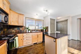 Photo 7: 742 EVERRIDGE Drive SW in Calgary: Evergreen Detached for sale : MLS®# A1061087