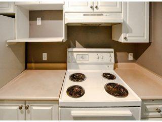 "Photo 2: 114 7505 138TH Street in Surrey: East Newton Condo for sale in ""Midtown Villa"" : MLS®# F1417804"