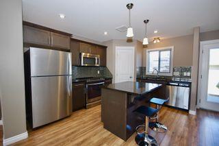 Photo 9: 414 Maningas Bend in Saskatoon: Evergreen Condominium for sale