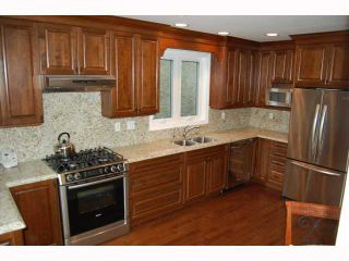 """Photo 2: 317 W 22ND Avenue in Vancouver: Cambie House for sale in """"CAMBIE VILLAGE"""" (Vancouver West)  : MLS®# V817335"""