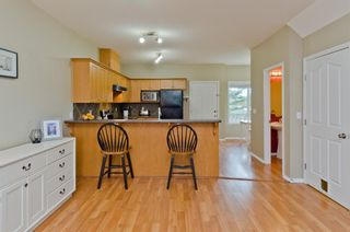 Photo 8: 205 2006 LUXSTONE Boulevard SW: Airdrie Row/Townhouse for sale : MLS®# A1010440