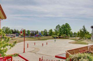 Photo 32: 105 Rocky Ridge Court NW in Calgary: Rocky Ridge Row/Townhouse for sale : MLS®# A1069587