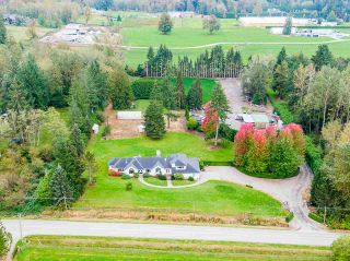 Photo 1: 24114 80 Avenue in Langley: County Line Glen Valley House for sale : MLS®# R2516295