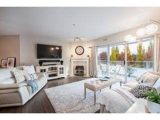 """Main Photo: 308 5377 201A Street in Langley: Langley City Condo for sale in """"Red Maple Place"""" : MLS®# R2627459"""