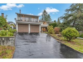 Main Photo: 811 HUBER Drive in Port Coquitlam: Oxford Heights House for sale : MLS®# R2625510