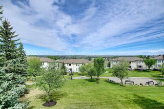 Photo 30: 106 Hamptons Link NW in Calgary: Hamptons Row/Townhouse for sale : MLS®# A1117431