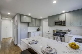 Photo 11: CLAIREMONT House for sale : 4 bedrooms : 5440 Norwich Street in San Diego