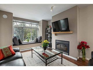 """Photo 1: 113 1111 LYNN VALLEY Road in North Vancouver: Lynn Valley Condo for sale in """"THE DAKOTA"""" : MLS®# V1052870"""