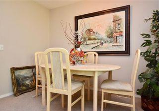 Photo 5: 816 MADEIRA Drive NE in Calgary: Marlborough Park Row/Townhouse for sale : MLS®# C4262604