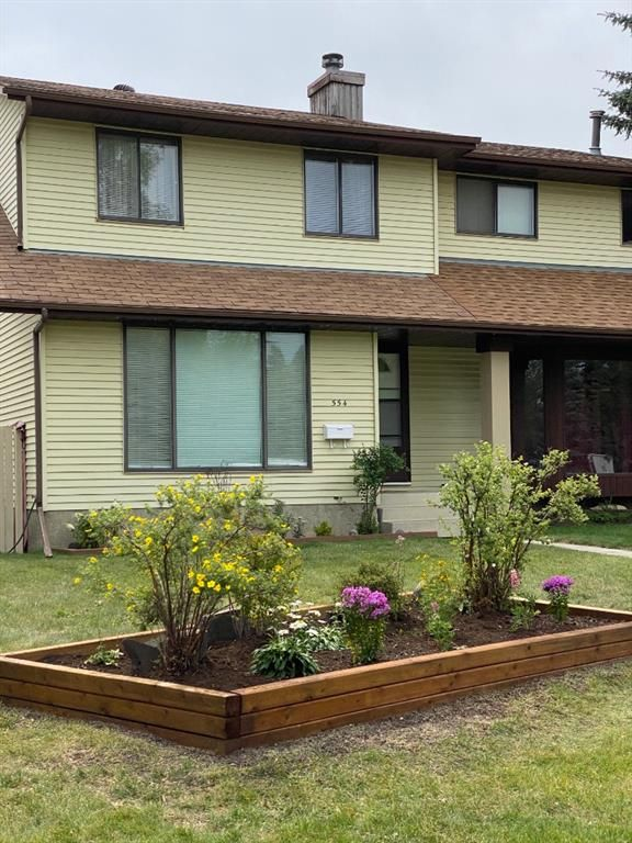 Main Photo: 554 STRATHCONA Drive SW in Calgary: Strathcona Park Semi Detached for sale : MLS®# A1020759