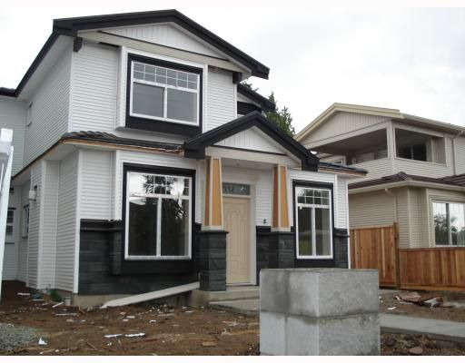 Main Photo: 7152 CANADA Way in Burnaby: Burnaby Lake 1/2 Duplex for sale (Burnaby South)  : MLS®# V764368